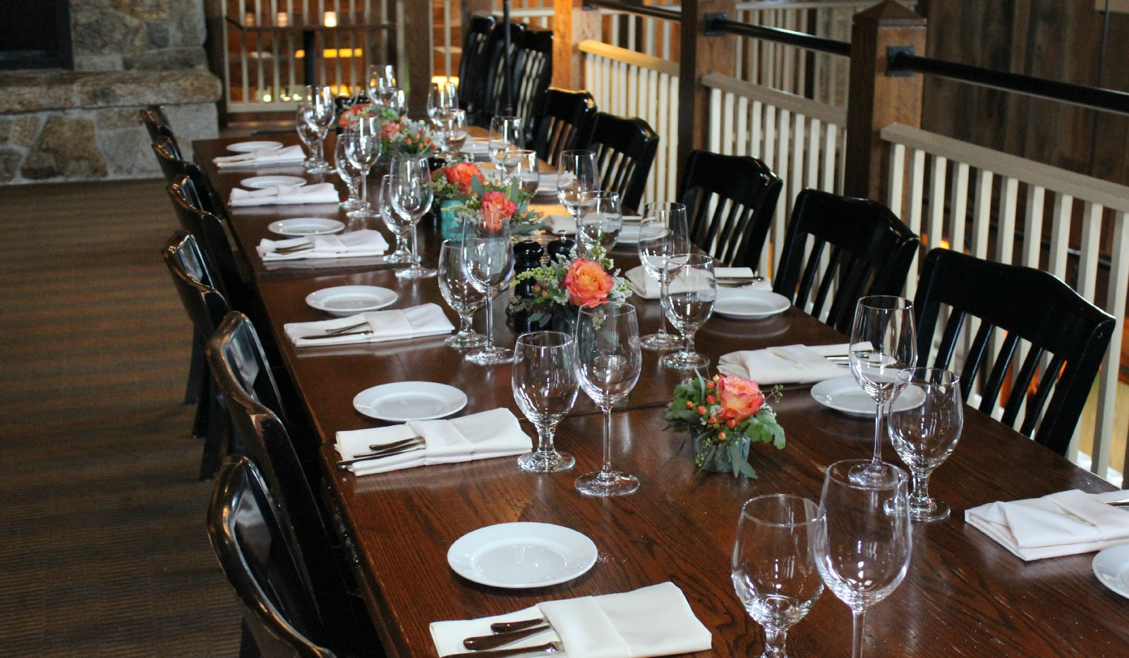 Long table set with bud vases down the middle