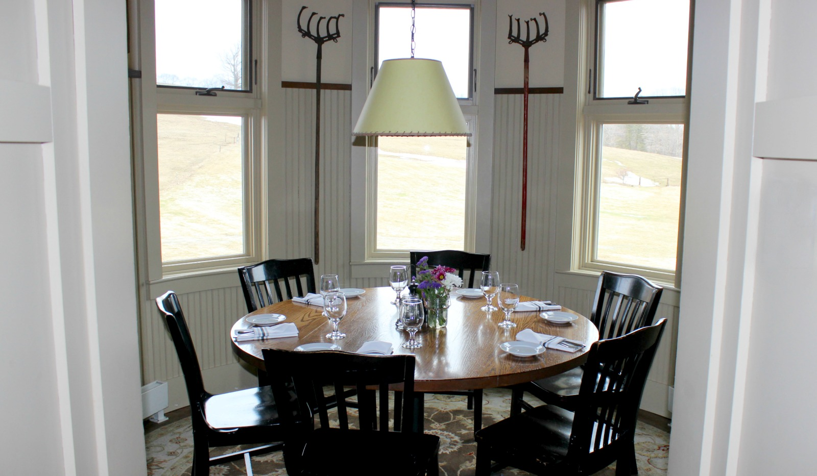 Silo with round table set for six guests